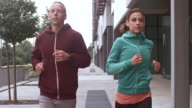 SLO MO TS Couple jogging in the city video