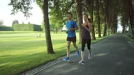 SLO MO TS Couple jogging through a park video