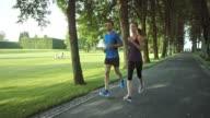 SLO MO TS Couple jogging through a park video