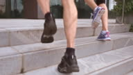 SLO MO TS Couple jogging up the stairs video
