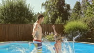 SLO MO CS Couple jumping into pool together video