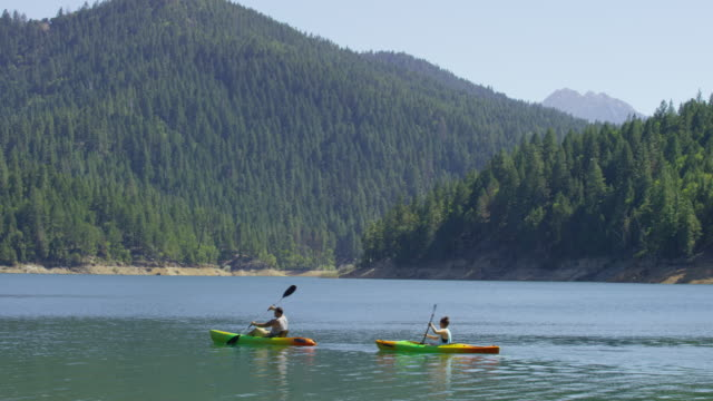 Couple kayaking in lake video