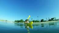 Couple Kayaking In Ocean HD video