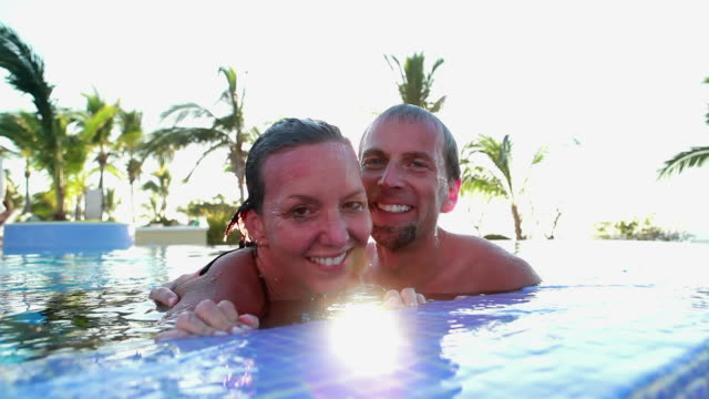 Couple kiss in swimming pool video