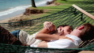 Couple kisses in hammock video