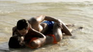 couple kissing and caressing in the water video