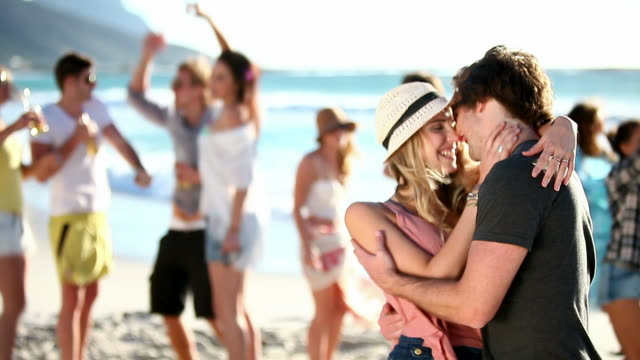 Couple Kissing At A Beach Party video