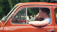 Couple kissing in car video