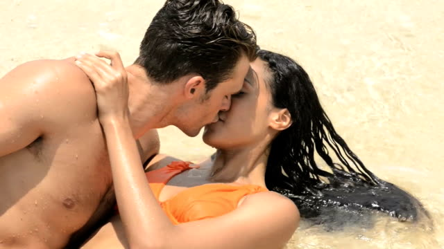 Couple kissing in the water video
