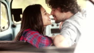 Couple kissing in vintage car video