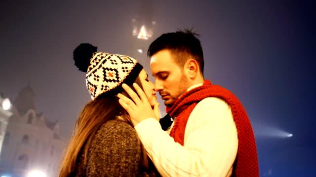 Couple kissing on winter night.q video