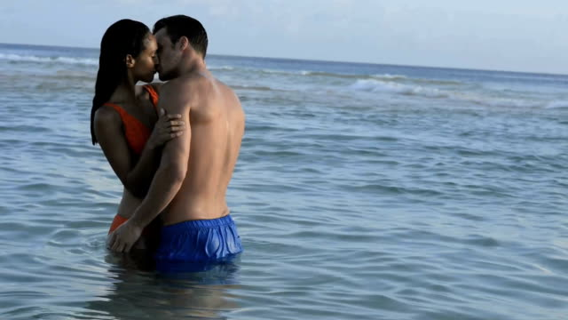Couple kissing standing in the sea video