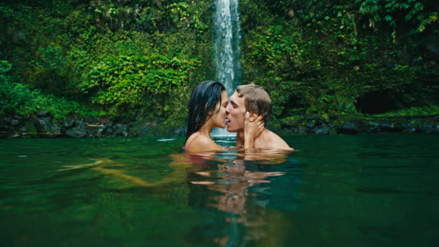 Couple Kissing Under Waterfall video