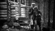 1934: Couple leaving rural log cabin for vacation fishing spot. video