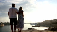 Couple look out across harbour, Valletta, Malta video