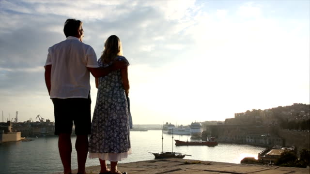 Couple look out across harbour, Valletta, Malta video
