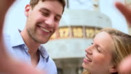 Couple looking at camera and smiling video