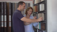 Couple looking at different floor options and agreeing on one video