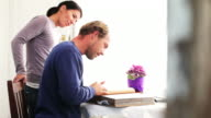Couple looking at photgraph album video