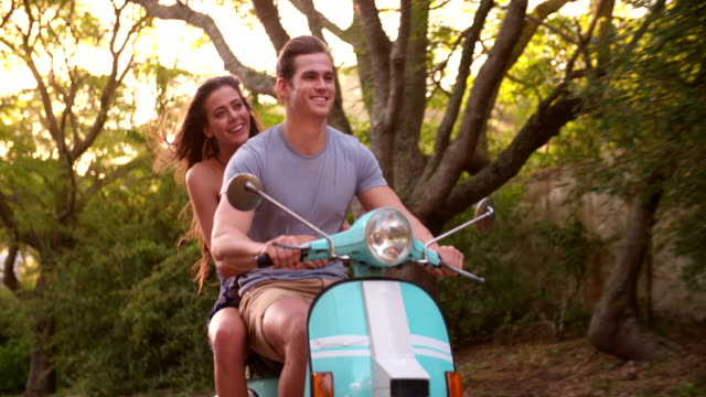 Couple loving a road trip on their scooter video
