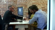 Couple Meeting With Financial Advisor In Office video