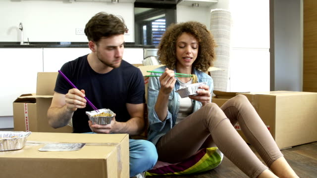 Couple Moving Into New Home Enjoying Takeaway Meal video