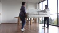 Couple moving into their new apartment video