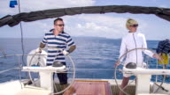 MS Couple Navigating A Sailboat Together video