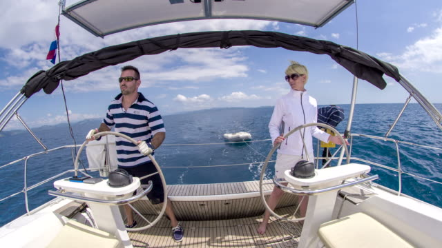 WS Couple Navigating A Sailboat video