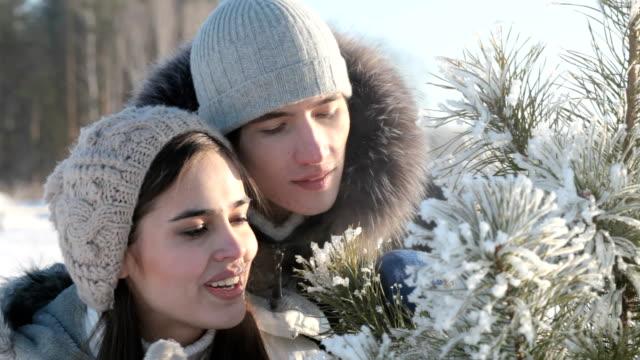 Couple near fir-tree video