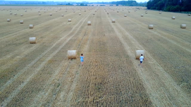 Couple Near Haystack At Countryside video