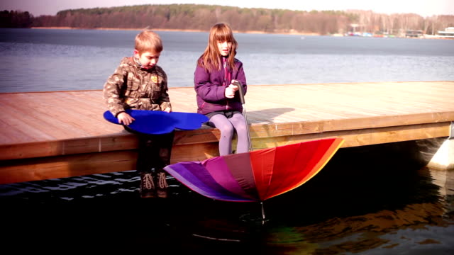 couple of kids playing on the lake video