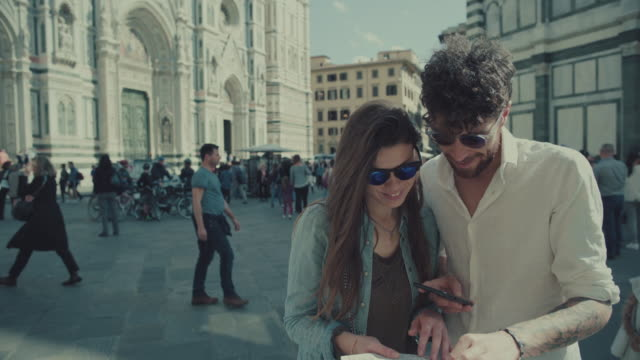 Couple of tourists in Florence, Italy WITH MAP video