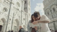 Couple of tourists in Piazza del Duomo, Florence video
