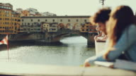 Couple of tourists near Ponte Vecchio, Florence video
