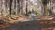 Couple on a walk in the fall video