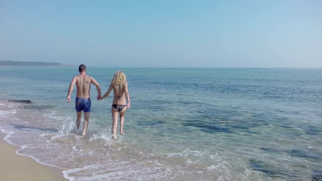 Couple on beach - slow motion video