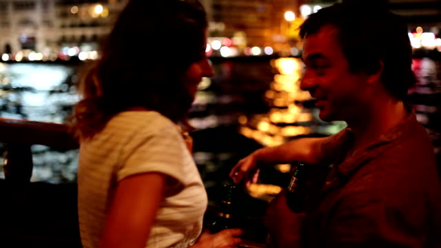 Couple on boat cruising at night video