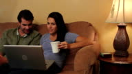 Couple on Couch Get the House Kiss Trackleft video