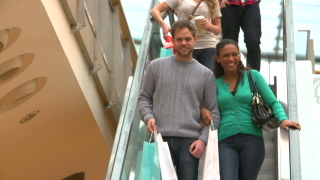 Couple On Escalator In Shopping Mall Together video