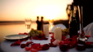 Couple on romantic date at beach restaurant at sunset video