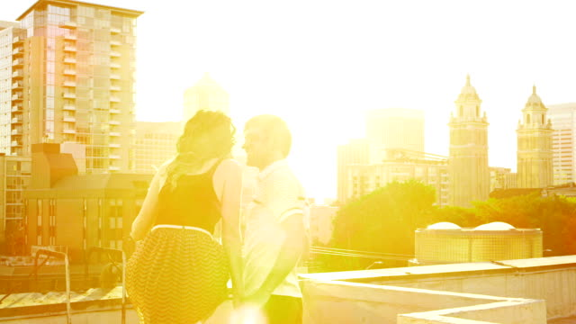 Couple on rooftop deck video