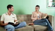 Couple on sofa reading video