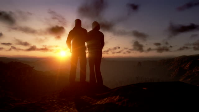 Couple on top of the mountain, close up, timelapse sunset video