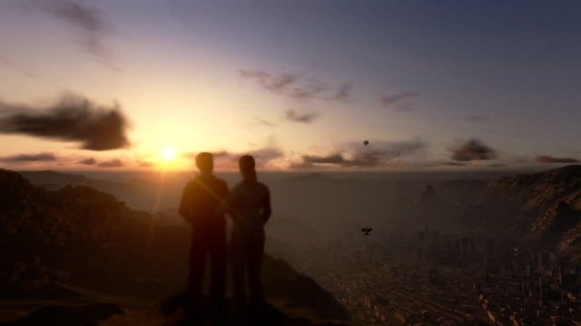 Couple on top of the mountain, timelapse sunrise, camera fly video