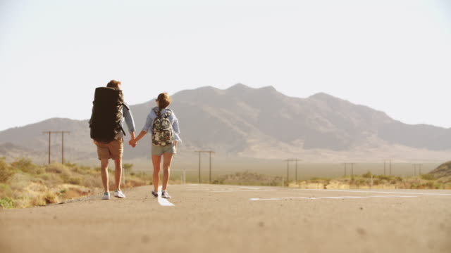 Couple On Vacation Hitchhiking Along Road Shot On R3D video