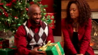 Couple opening Christmas gifts video