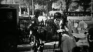1934: Couple packing up Ford model A car for fishing camping trip. video