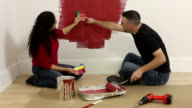 Couple painting room together video