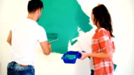 Couple painting walls. video